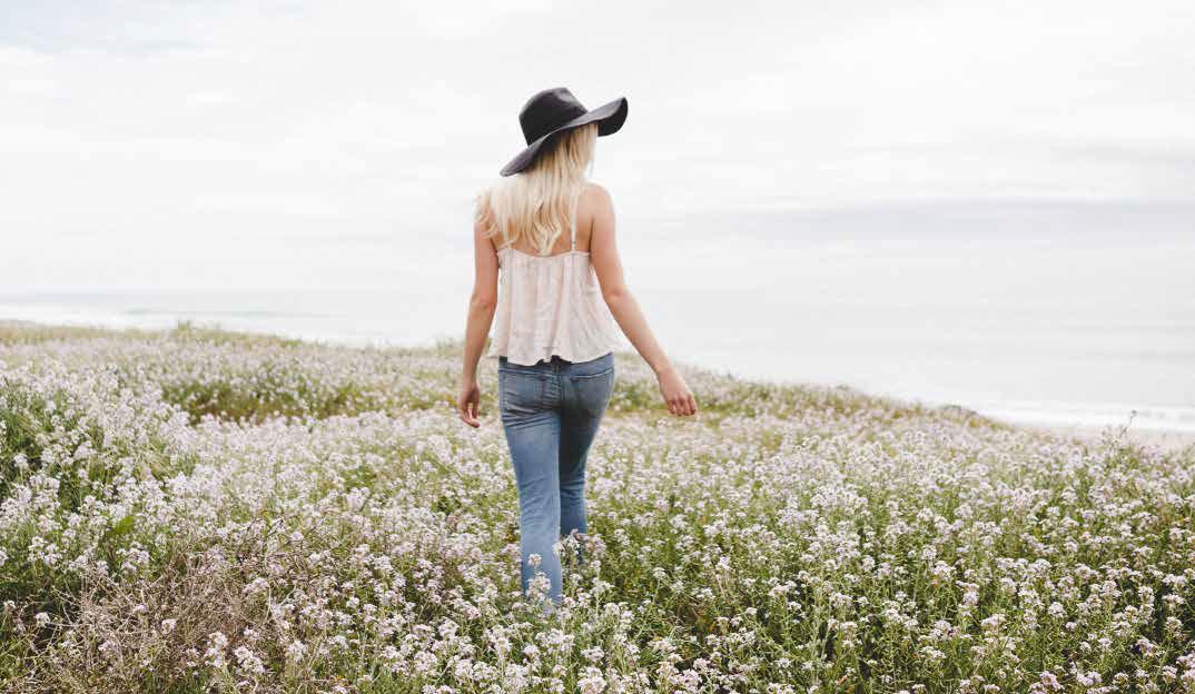 Lady walking threw flowers